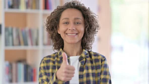 Portrait of Mixed Race Woman with Thumbs Up