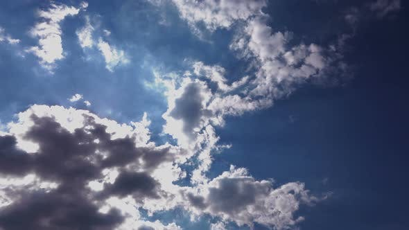 Thumbnail for White Clouds Running Over Blue Sky