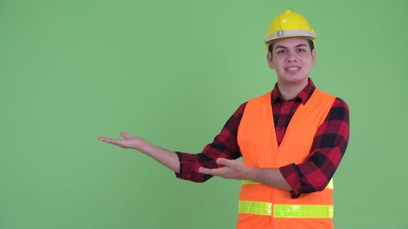 Thumbnail for Happy Young Multi Ethnic Man Construction Worker Talking While Showing Something