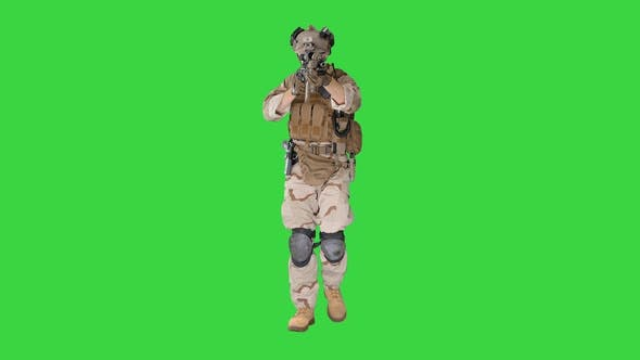 Soldier Walking and Aiming with Assault Rifle on a Green Screen, Chroma Key.