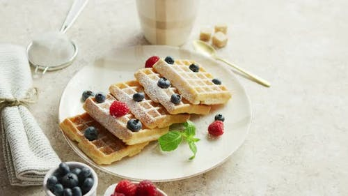 Waffles on Plate and Cup of Coffee