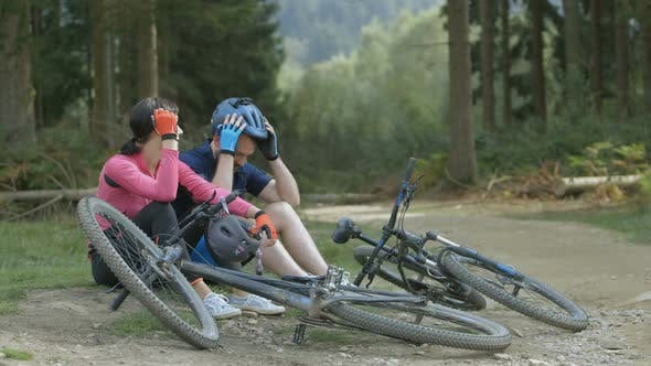 Thumbnail for Couple relaxing during cycling in forest