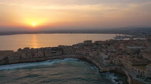A Bird's Eye View of Ortigia Island at Sunset. Sailing Ship Out of the Bay. Sicily