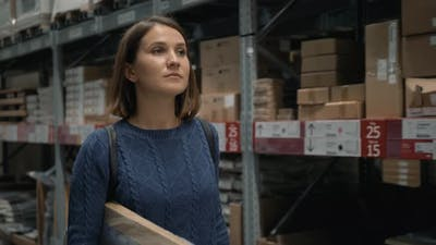 Young Female Carring Packing with Goods in Shop Warehouse