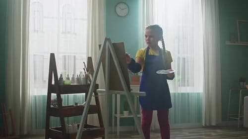 Diligent Girl Is Painting On Canvas