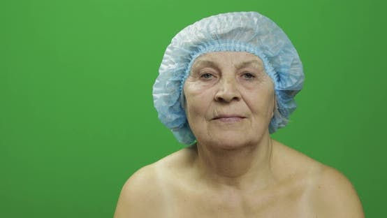 Thumbnail for Smiling Elderly Female Lady in Protective Hat Scared of Syringe with Medicines