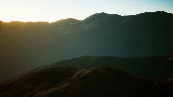 Hills with Rocks at Sunset