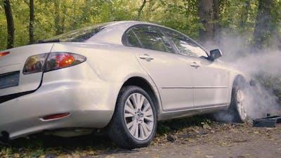 Broken Car Emitting Smoke After Accident
