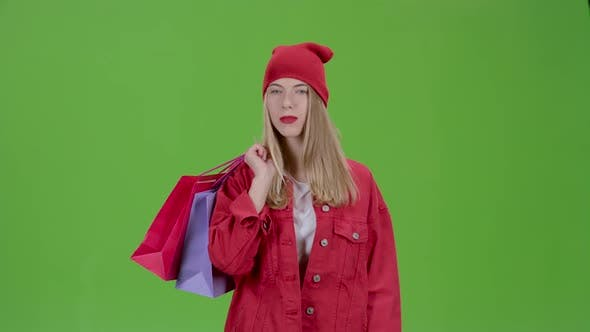 Thumbnail for Girl Comes with Bags in His Hands. Green Screen