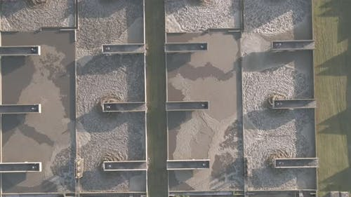 Drone Flying Directly Above Waste Water Plant