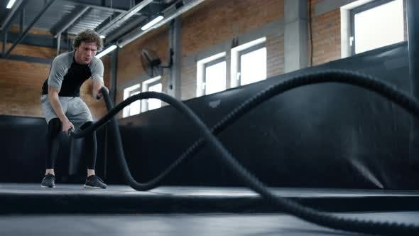 Thumbnail for Aggressive Kickboxer Doing Workout at Gym. Sportsman Using Battle Ropes