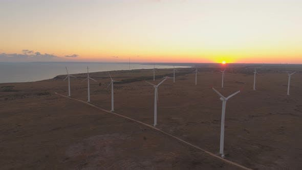 Thumbnail for Mesmerizing Landscape of Sea Coast and Sea Horizon at Sunset and Wind Turbines Generating Eco Energy
