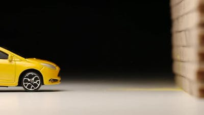 Crash test of yellow toy car
