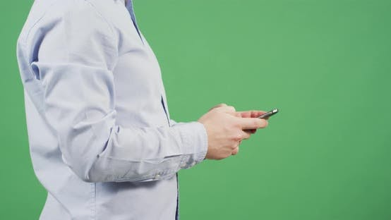 Thumbnail for Side view of hands texting on the mobile phone