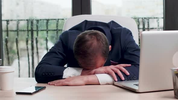 Thumbnail for Close Up Shot of Exhausted Businessman Sleeping at His Desk