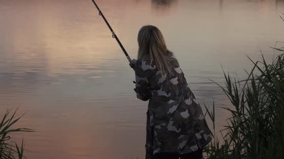 Fishing Girl Throws A Float Into The Water