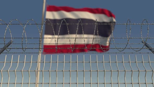 Thumbnail for Blurred Waving Flag of Thailand Behind Barbed Wire