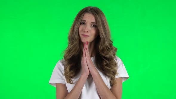 Thumbnail for Lovable Girl Keeps Palm Together and Asks for Something . Green Screen
