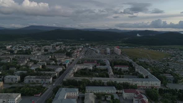 Thumbnail for Aerial view of city with hight and low buildings. Summer, evening