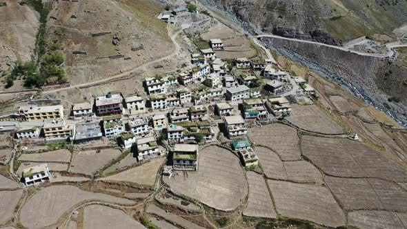 Thumbnail for Aerial Circular Shot of a Small Secluded Himalayan Village in Mudh Village , Spiti , Himachal