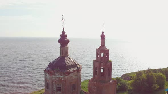 Thumbnail for Old Dilapidated Christian Church with Black Domes Near the River