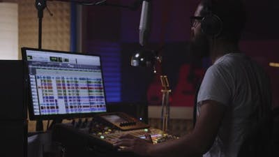 Man Recording His Own Voice Part in Studio
