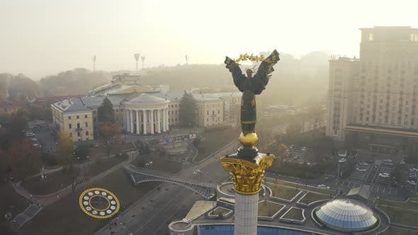 Maidan Nezalezhnosti Square at Foggy Weather. Independence Monument Berehynia in Kiev