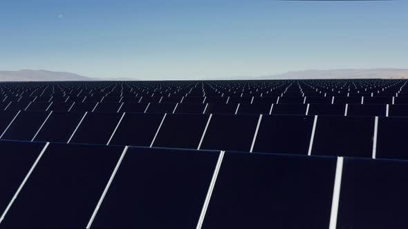 Thumbnail for Cinematic  Aerial View From Drone, Solar Farm in the Desert Landscape, USA