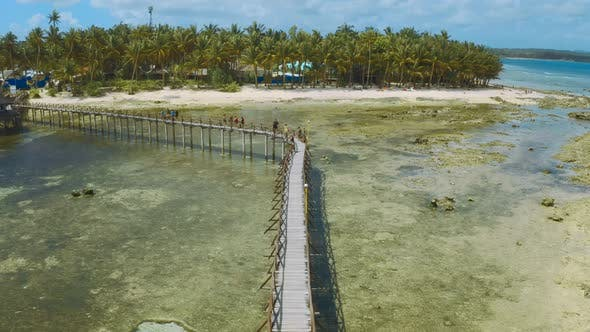 Cover Image for Wooden Pathway Over the Water Leading To the Viewing Deck for the Surfing Competition