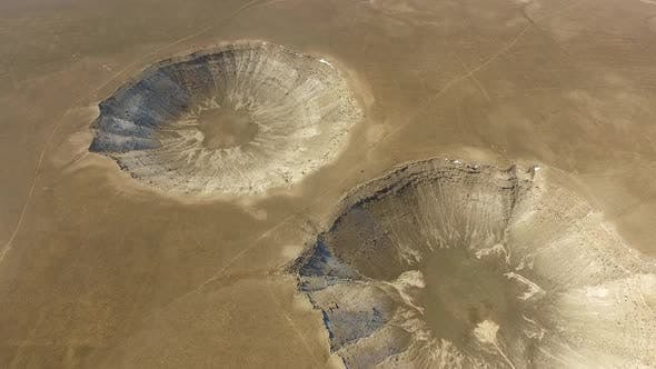 Large Meteor and Sinkhole Pits on Mainland Surface of Earth