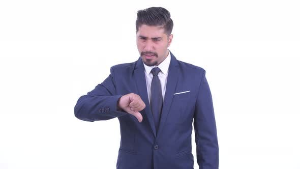Thumbnail for Angry Bearded Persian Businessman Giving Thumbs Down