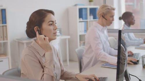 Diverse Hotline Receptionists at Work