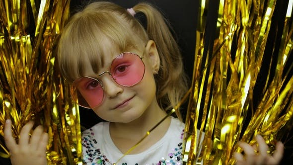 Cover Image for Portrait of Happy Child Playing, Fooling Around in Foil Fringe Golden Curtain. Little Blonde Kid
