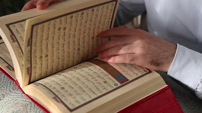 Young Muslim Learning Quran