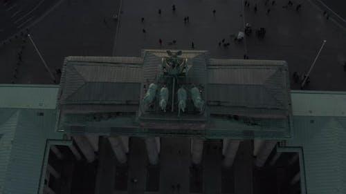 AERIAL: Overhead Birds View on Brandenburg Gate with Quadriga Green Statue in Berlin, Germany