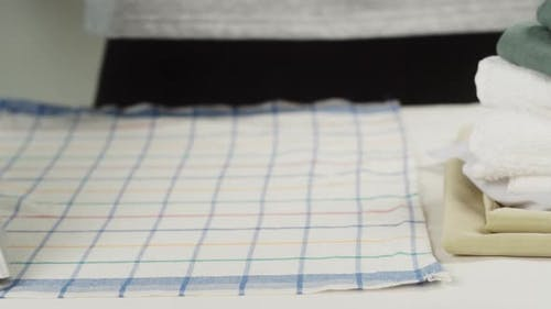 Ironing Bath Towels with Steam on Iron Board Closeup