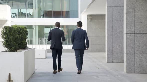 Diverse Businessmen Walking Outdoors