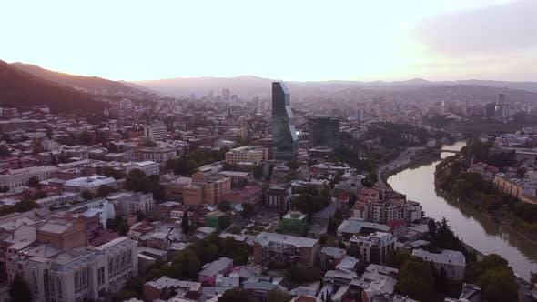 Glass Skyscraper In The Sunset City