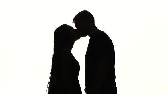 Thumbnail for Portrait of Two People Kissing. Silhouette. White