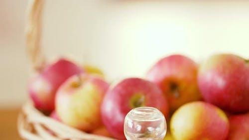 Apples in Basket and Jug of Juice or Vinegar 32