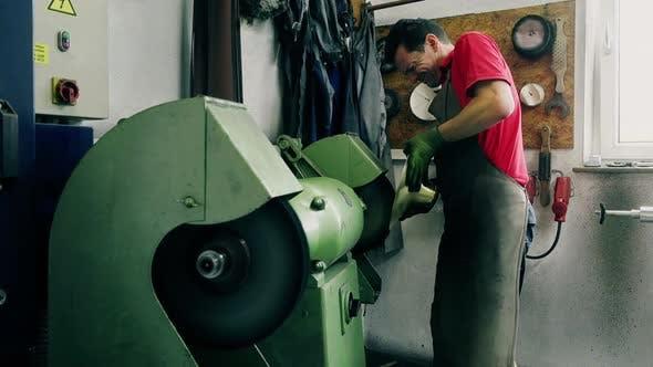 Craftsman polishing trumpet