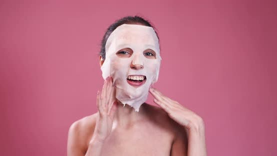 Thumbnail for Happy Girl with Facial Mask Having Fun