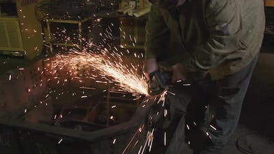 Welding Iron At Industrial Plant