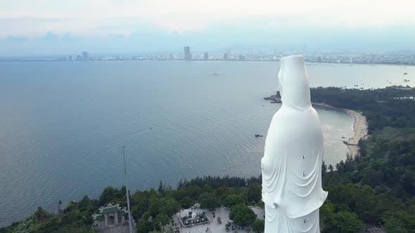 Thumbnail for Aerial View White Buddha Statue on Ocean Coast Hilltop