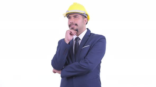 Thumbnail for Happy Bearded Persian Businessman As Engineer Thinking