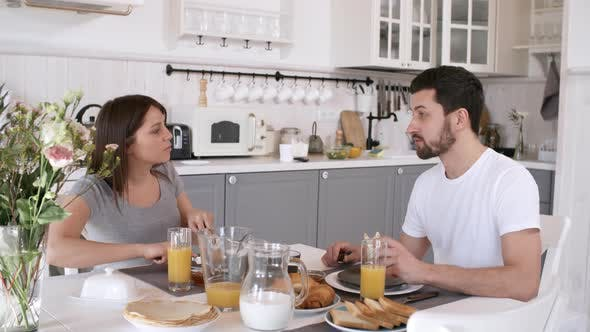 Thumbnail for Couple Eating Breakfast and Chatting