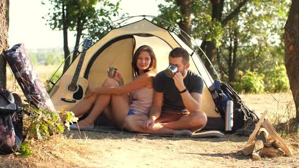 Thumbnail for Couple Drinking Tea at Campsite Tent