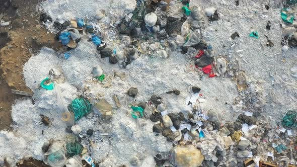 Thumbnail for Aerial Shot of Rubbish Pile Lying Among Countryside. Flying Over Huge Dump Trash with Plastic and