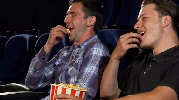 Thumbnail for Male Friends Eating Popcorn and Laughing While Watching Comedies at the Cinema