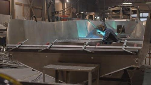 Worker Welding in Framework of Boat